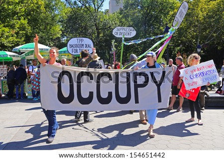 NEW YORK CITY - SEPTEMBER 17 2013: Occupy Wall Street  marked its second anniversary with a rally at Zuccotti Park & march to Washington Square Park on September 17 2013 in New York City - stock photo