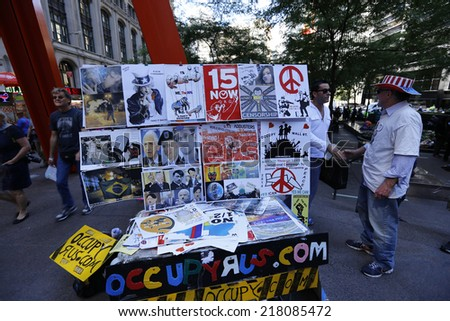 NEW YORK CITY - SEPTEMBER 17 2014: Occupy Wall Street marked the third anniversary of its founding as several dozen activists gathered in Zuccotti Park. Literature & sign table at Zuccotti Park - stock photo