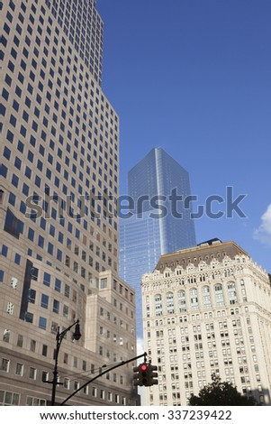 New York City, 11 september 2015: red traffic lights and high rise buildings in lower manhattan new york - stock photo