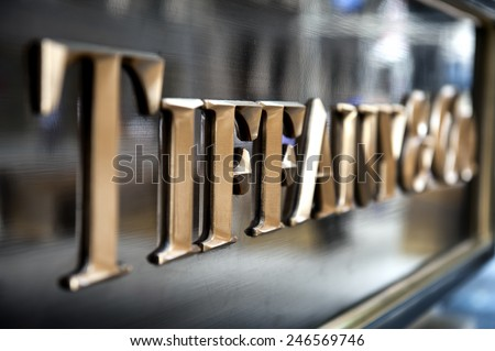 NEW YORK CITY - SEPTEMBER 12: Sign at Tiffany & Co. Building on Wall Street in NYC on September 12 2013. Tiffany's is a luxury American multinational jewelry and silverware corporation. - stock photo