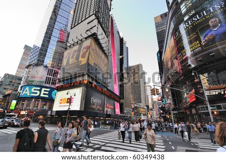 "NEW YORK CITY - SEPTEMBER 4: The intersection of Broadway and 42nd Street, dubbed ""Crossroads of the World"" September 4, 2010 in New York City. - stock photo"