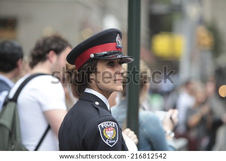 NEW YORK CITY - SEPTEMBER 11 2013: the 13th anniversary of the WTC terror attacks was observed in Lower Manhattan by first responders & relatives of attack victims. Canadian police officer - stock photo