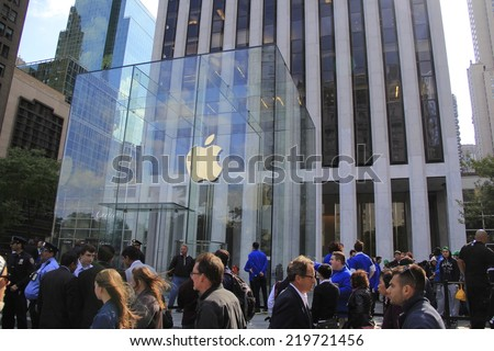 NEW YORK CITY - SEPTEMBER 19: Thousands of customers wait in line outside of the Apple Store on Fifth Avenue to be among the first to purchase the new iPhone 6 on September 19, 2014.  - stock photo