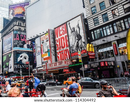 NEW YORK CITY -SEPTEMBER 24: Times Square, featured with Broadway Theaters and animated LED signs, is a symbol of New York City and the United States, September 24, 2010 in Manhattan, New York City. - stock photo