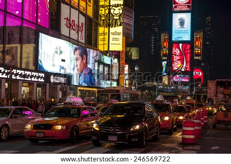 NEW YORK CITY - SEPTEMBER 19: Times Square, featured with Broadway Theaters and animated LED signs, is a symbol of New York City and the United States, September 19, 2013 in Manhattan, New York City. - stock photo