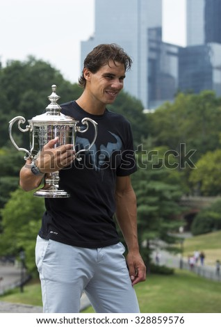 NEW YORK CITY - SEPTEMBER 10, 2013: US Open 2013 champion Rafael Nadal posing with US Open trophy in Central Park  - stock photo
