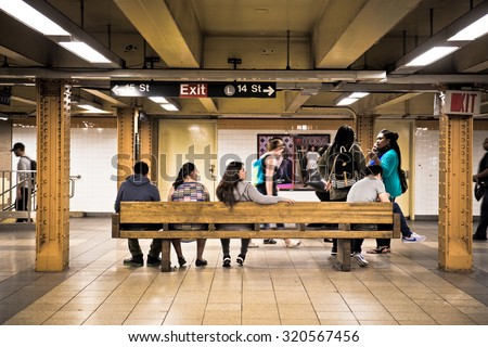 NEW YORK CITY - SEPTEMBER 24, 2015:  View of underground subway station at 14th Street in New York City with people waiting.  - stock photo