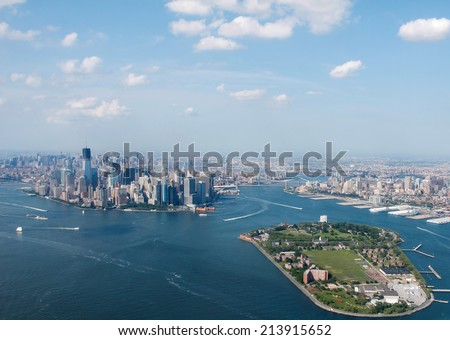 New York City Sky View With Governors Island Infront - stock photo
