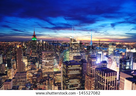 New York City skyline aerial view at dusk with colorful cloud, Empire State and skyscrapers of midtown Manhattan. - stock photo