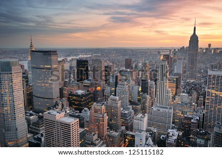 New York City skyline aerial view at sunset with colorful cloud and skyscrapers of midtown Manhattan. - stock photo