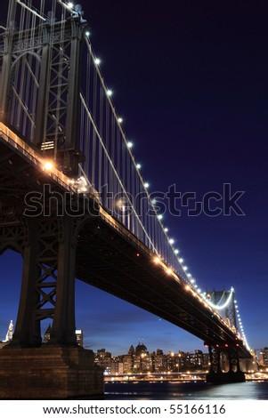 New York City Skyline and Manhattan Bridge At Night - stock photo