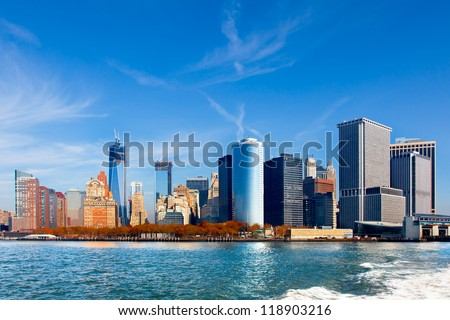 New York City skyline and waterfront viewed from the water facing lower Manhattan. Wide angle view includes the new World Trade Center under construction. - stock photo