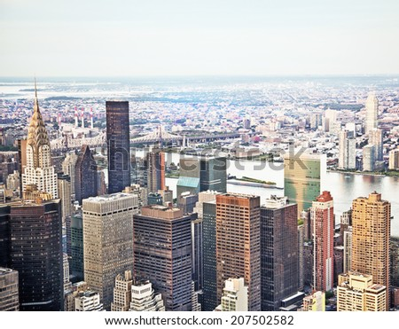 New York City skyline during the day with views of Chrysler Building and Randalls Island - stock photo