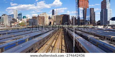 New York City skyline from the High Line with view of Hudson Yards trains - stock photo