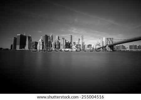 New York City Skyline, Manhattan and Brooklyn bridge view in black and white - stock photo
