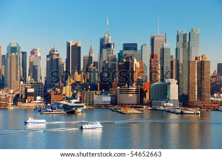 New York City skyline over Hudson river with boat and skyscrapers. - stock photo