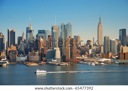 New York City skyline panorama over Hudson river with Empire State Building, boat and skyscraper. - stock photo