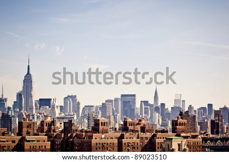 New York city skyline taken from Brooklyn bridge - stock photo