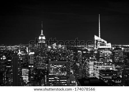 New York City skyline with urban skyscrapers at night, in black and white. - stock photo
