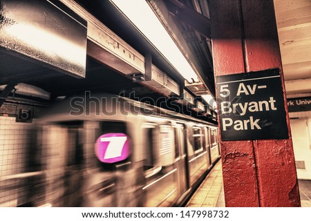New York City subway passageway and sign to 5 Av. Bryant Park. - stock photo
