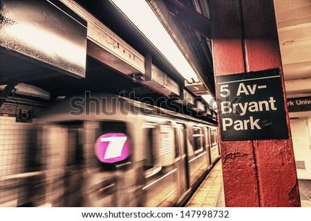 New York City subway passageway and sign to 5 Av. Bryant Park. - stock photo