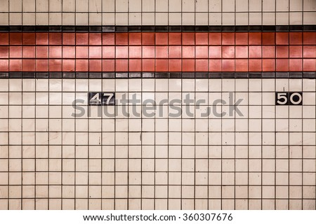 New York City subway tiled wall in midtown Manhattan  - stock photo