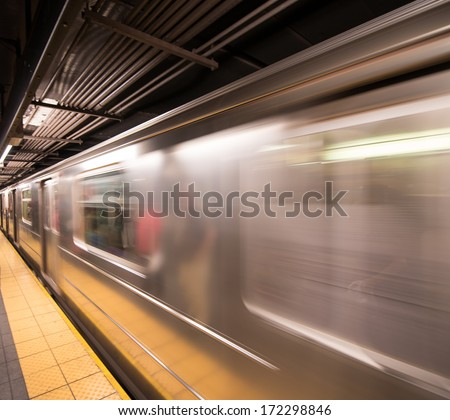 New York City. Subway train arriving in the station. - stock photo