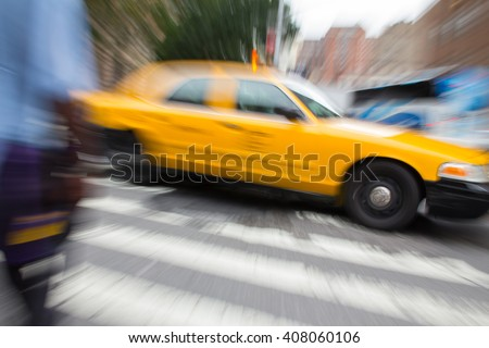New York City Taxi racing down the street - stock photo