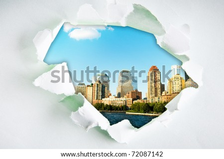 New York city through hole in paper - stock photo