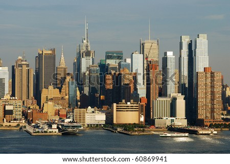 New York City Times Square Manhattan skyline at sunset with skyscrapers over Hudson river. - stock photo
