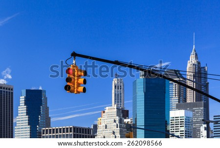 New York City Traffic Light.  A set of traffic lights in New York City with the Manhattan skyline in the background. - stock photo