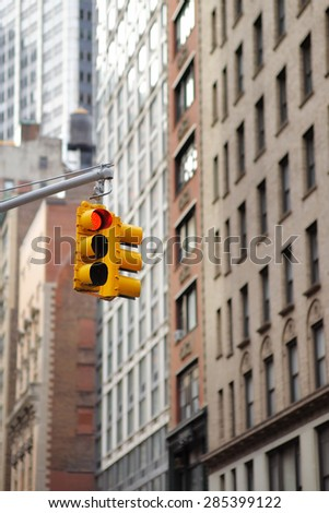 New York City Traffic Light with skyscrapers on background   - stock photo