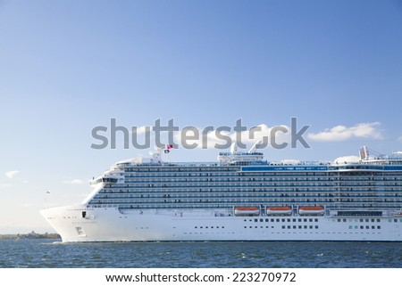 New York City, U.S.A - October 4, 2014: A large cruise ship is sailing at Hudson River.  View from Louis Valentino Junior Park at Brooklyn, New York City. - stock photo