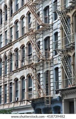 New York City, United States - old residential buildings in Soho district. Fire escape stairs. - stock photo