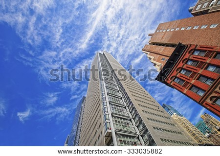 NEW YORK CITY, USA - APRIL 25, 2015: Bottom up view of skyscrapers in New York, USA. New York City skyscrapers are concentrated in Manhattan        - stock photo