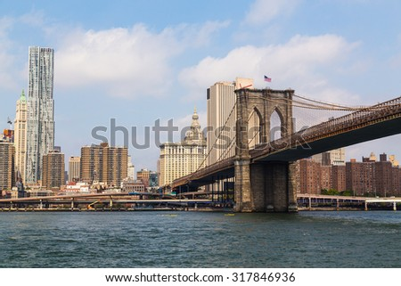 NEW YORK CITY, USA - AUGUST 31, 2015: Brooklyn Bridge and buildings in downtown New York City during the day. - stock photo