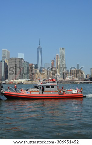 New York City, USA - August 16, 2015: FDNY boat responding to an emergency on the East River in New York City. - stock photo