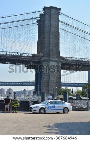 New York City, USA - August 16, 2015: New York City Police cruiser at Brooklyn Bridge Park responding to an emergency on the East River in New York City. - stock photo