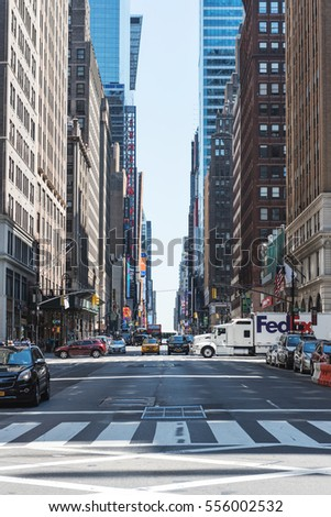 NEW YORK CITY, USA - CIRCA JUNE, 2016: A view of streets of manhattan on a sunny day from the middle of the road. Midtown Manhattan, New York City.