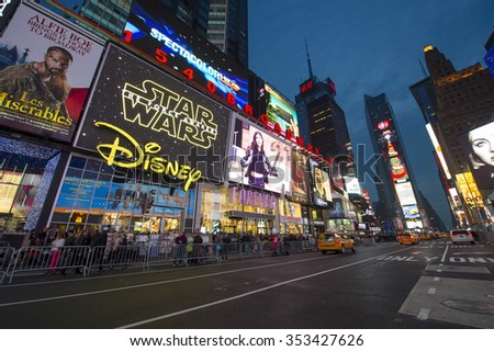 NEW YORK CITY, USA - DECEMBER 13, 2015: Bright signage flashes over holiday crowds as Times Square gets prepared for New Year's Eve celebrations. - stock photo