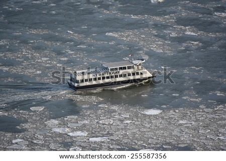 New York City, USA - February 24, 2015: New York Stock commuter ferry on the frozen East River as record low temperatures continue in New York City.  - stock photo