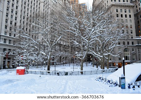 New York City, USA - January 24, 2016: Bowling Green Park covered in snow following the blizzard of 2016 in New York City.