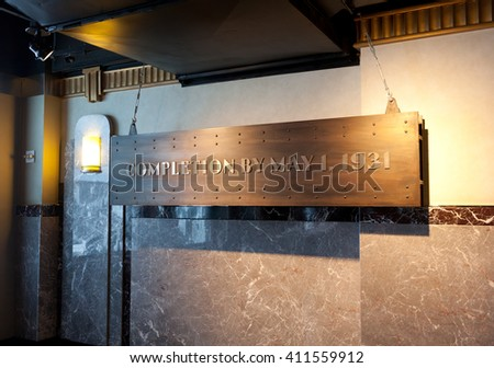 "New York City, USA - July 10, 2015: Nameplate, in the observatory of the Empire State Building, which says: ""completion by may 1 ,1931"" - stock photo"