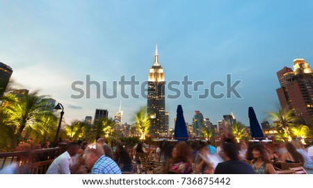 New York City USA - July 13 2015: View of the famous Empire State Building at sunset. This view is from the rooftop of the 230-fifth Bar.