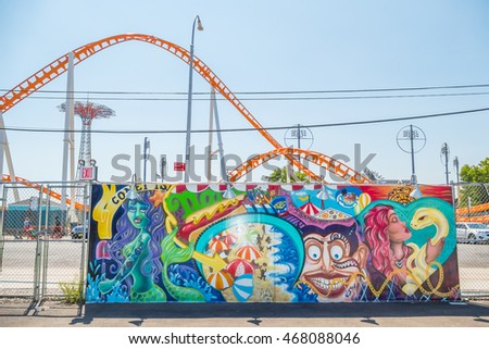 "NEW YORK CITY, USA - JUNE 25, 2016: ""Coney Island Roller Coaster Life"", wall project by Lady Pink, Coney Art Walls, the outdoor museum of street art"