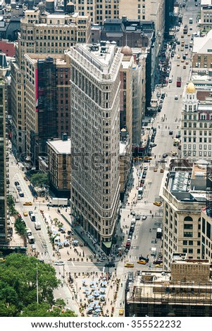 NEW YORK CITY, USA - JUNE 15: Flatiron Building designed by Chicago's Daniel Burnham was designated a New York City landmark in 1966, on June 15, 2015 in New York City.