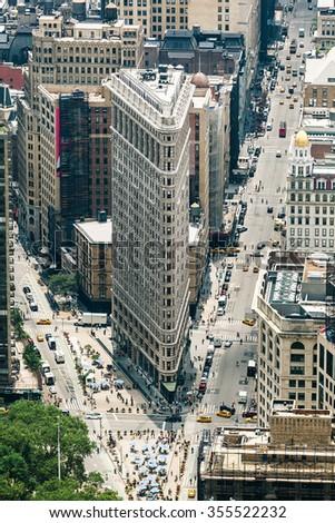 NEW YORK CITY, USA - JUNE 15: Flatiron Building designed by Chicago's Daniel Burnham was designated a New York City landmark in 1966, on June 15, 2015 in New York City.  - stock photo