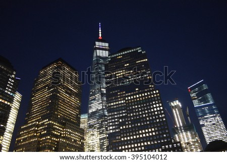 New York City, USA - March 22, 2016: Spire of One World Trade Center lit in solidarity following the terrorist attacks in Belgium in Lower Manhattan in 2016 in New York City.
