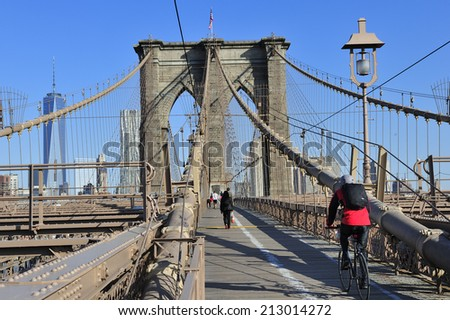 New York City, USA, - May. 19. 2014: Bike riders commuting to Manhattan over Brooklyn Bridge. New York, USA - stock photo
