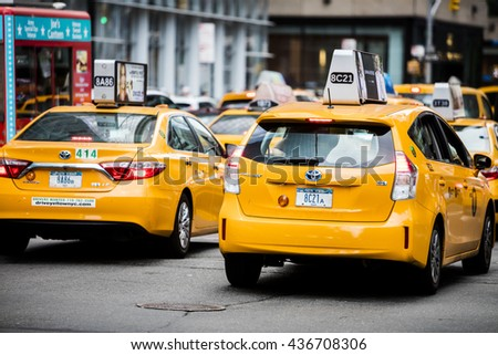 NEW YORK CITY, USA - May 28, 2016: Famous new York City cabs looking for customers in the midtown area of Manhattan - stock photo